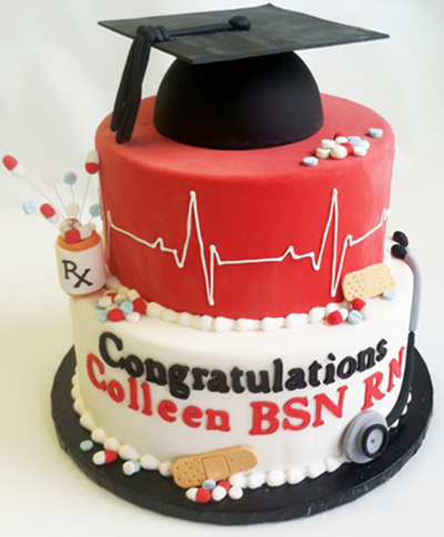 nurse of doctor graduation cake with bandaids presciption and stethoscope