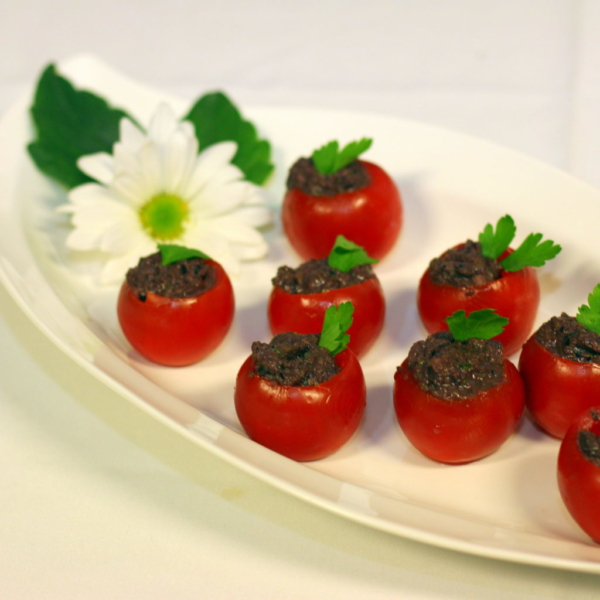 vegan appetizer tomatoes stuffed with Tapenade