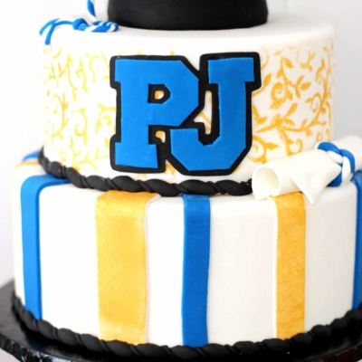 graduation cake with diploma and hat