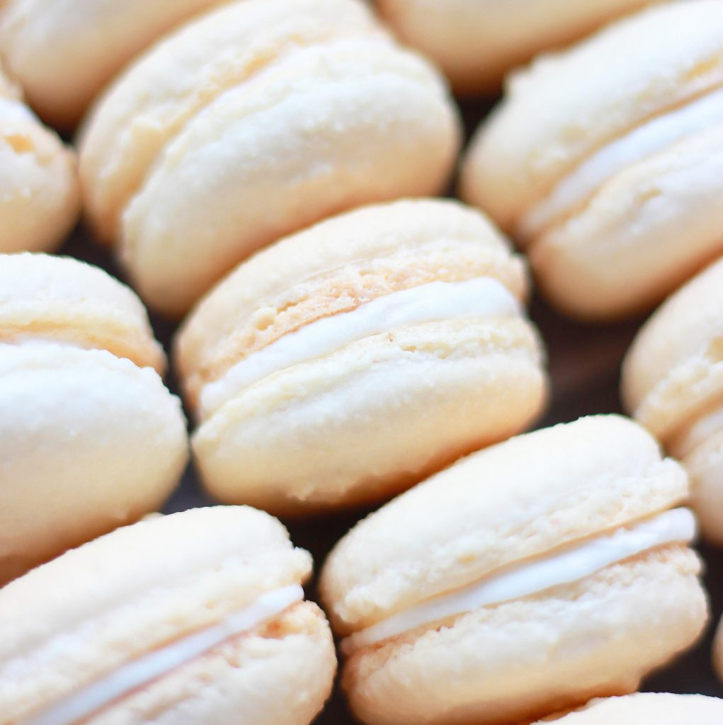 salted caramel lighter colored cookies with white filling